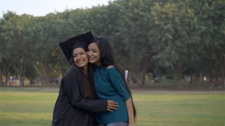 Beautiful Indian girl coming to congratulate her best friend on university graduation