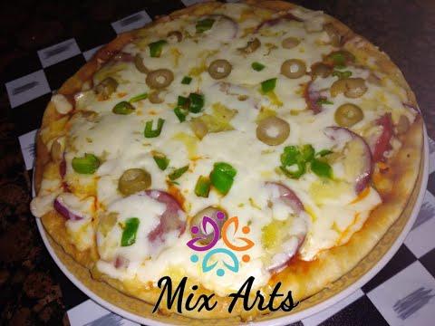 صورة  طريقة عمل البيتزا اسهل طريقة لعمل بيتزا الطاسة فى خمس دقائق طريقة عمل البيتزا من يوتيوب