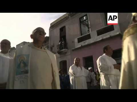 Catholics take part in procession to honour Cuba's patron saint, Our Lady of Charity