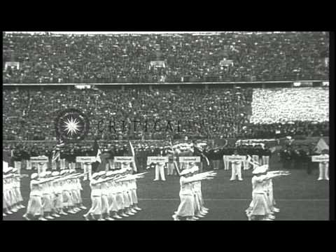 Hitler presides over the opening of the 1936 Olympics while U.S. team member Jess...HD Stock Footage