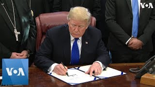 Trump Signs Bill to Help Minorities in Iraq, Syria