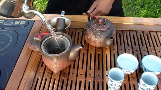 Preparing, serving and drinking wild / natural tea - Golden Triangle, Northern Thailand