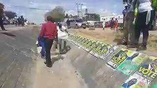 Zanupf supporters placing Election posters on top of other candidates