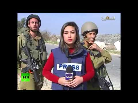 IDF soldiers trolling Palestinian news reporter's live broadcast