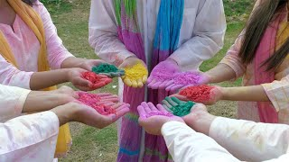 Group of Indian teenagers holding handfuls of Gulal colors during Holi festival
