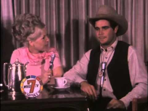 """Bette Rogge interviews """"Gunsmoke"""" actors Ken Curtis and Buck Taylor."""