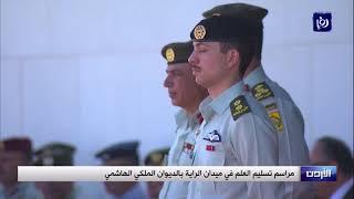الملك يسلم علم جلالة القائد الأعلى إلى كتيبة أم الشهداء  - (9-4-2019)