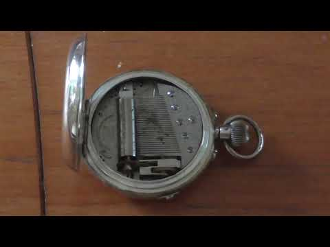 Antique musical pocket watch