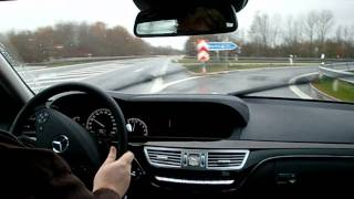 Mercedes S350 BlueTec driven through town in the rain