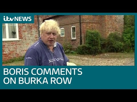 Boris Johnson greets the media armed with a tray of mugs amid burka row  ITV