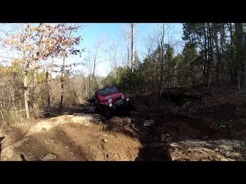 Jeep TJ Having Trouble In The Muddy Rocks