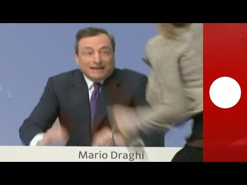 Protester attacks ECB cheif Mario Draghi during news conference