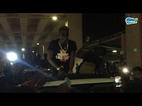 Shatta Wale surprises fans by coming out from a different direction from the KIA Airport