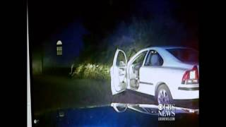 Caught on camera: Cop shot in car, fellow officer finds him