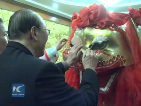 North Korean top official draws eyes of dancing lion at Chinese embassy
