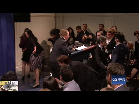Thumbnail: SNL Skit Melissa McCarthy Sean Spicer Press Conference Podium Armageddon Rampage Reporter Attack