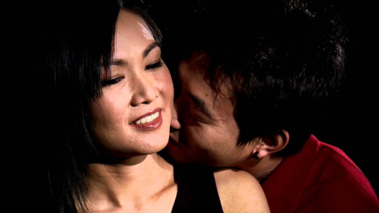 Man Kissing A Womans Neck, Asian Couple - Stock Video -1157