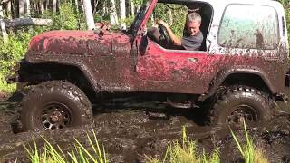 4 cylinder jeep in deep mud