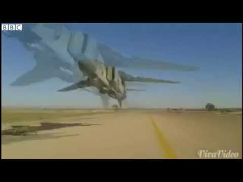 Libya jet skims heads in very low fly by