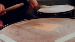 Closeup shot of drummer playing with sticks on a snare drum