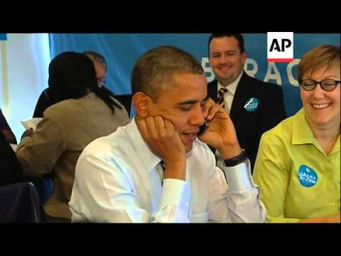 Obama visits his campaign headquarters in Chicago and calls voters