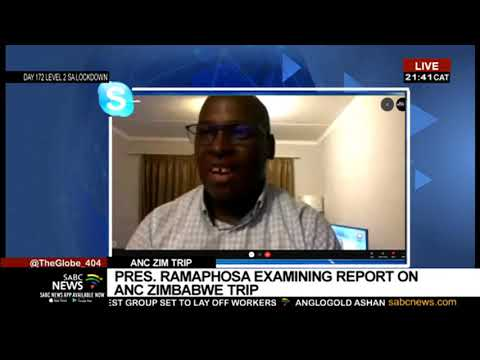 President Ramaphosa examining the Zimbabwe ANC trip report