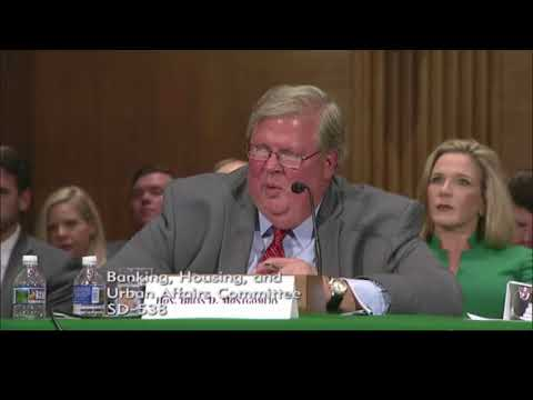 Elizabeth Warren asks Trump nominee Brian Montgomery about his use of the revolving door