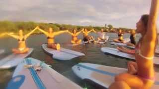Sun Salutations on the water!  Sup Yoga with Dashama