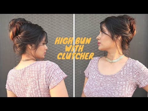 high-bun-hairstyle-with-side-partitioning-using-clutcher-/hairstyle-for-medium-hair