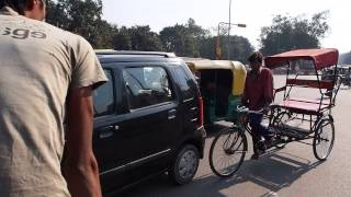 Crazy cycle rickshaw weaving through traffic in New Delhi
