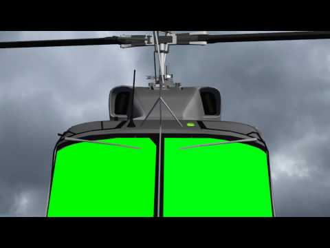 flying helicopter with green screen cockbit