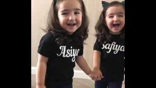 Laughing baby cute twins sisters