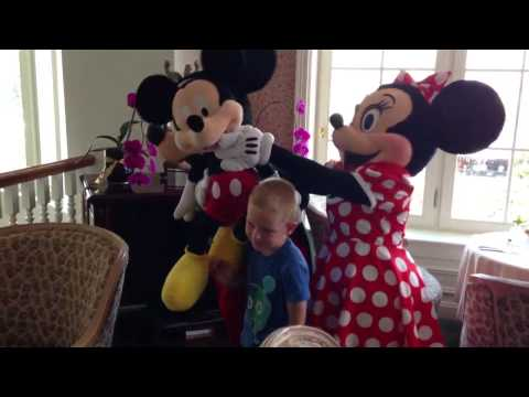 Meeting Mickey and Minnie at Disneyland Paris Castle Club extra show with little Mickey figure