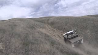 2wd solid axel yota with locker vs 4wd stock toyota