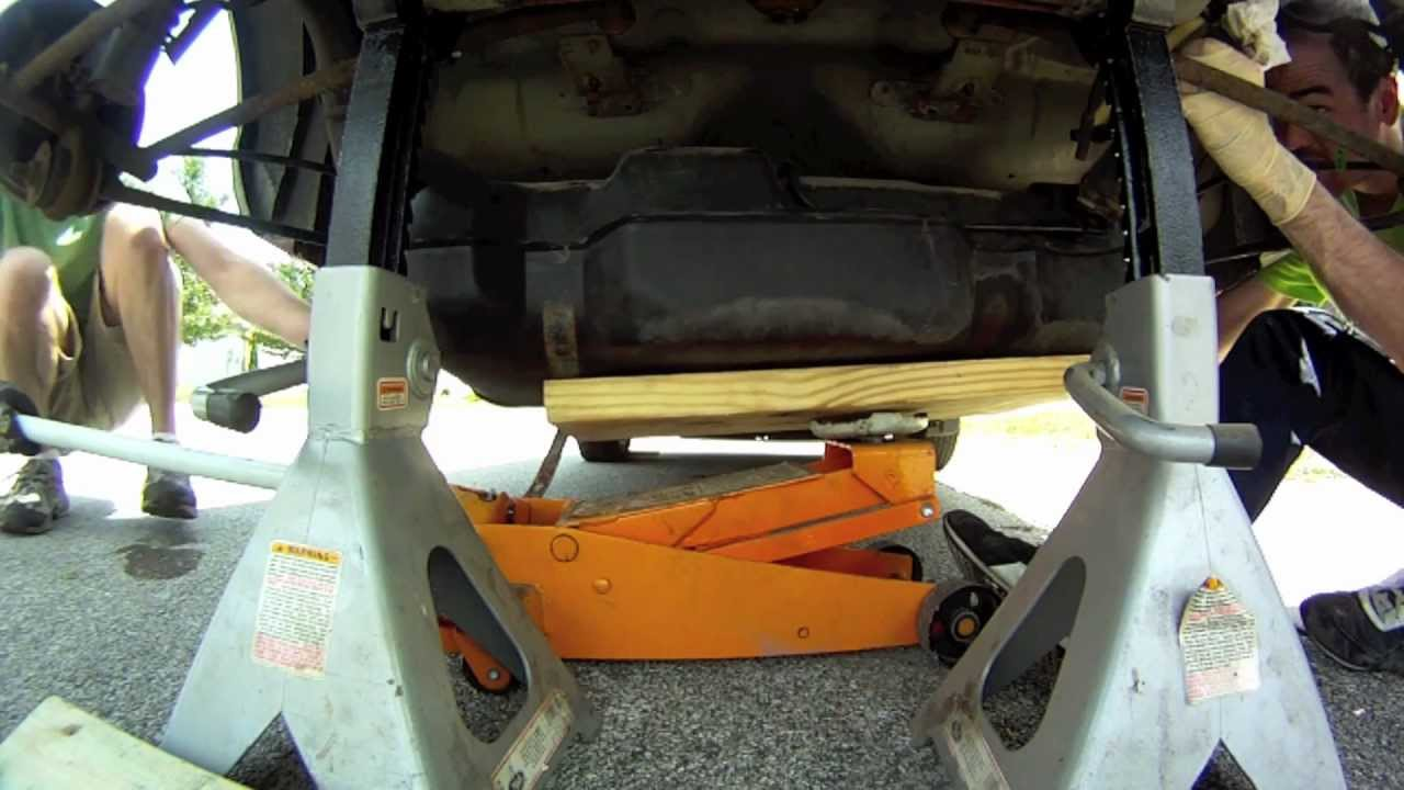 change a fuel pump on a Dodge Neon - YouTube