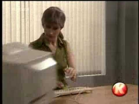 A woman mistakens a computer for a typewriter
