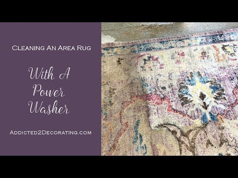 Cleaning an area rug with a power washer