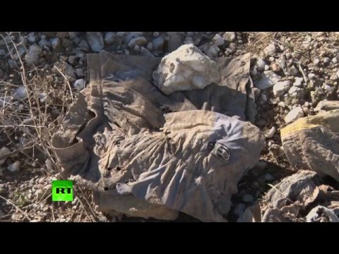 RAW: Mass grave believed to be of Yazidi men killed by ISIS found near Iraq's Sinjar