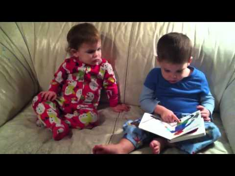 Cayden reading to Isabella (lion lion, what do you see?)