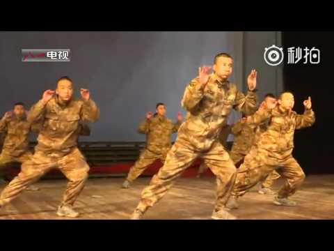 Chinese soldiers dance to celebrate the Chinese New Year, the Year of the Rooster