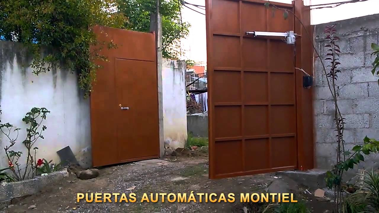 Puerta autom tica abatible hacia adentro con pistones for Puertas que abren hacia afuera