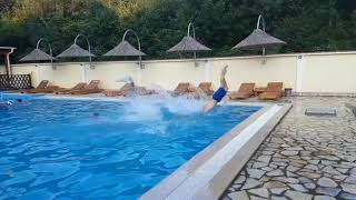 Allfails  three guys dive second guy trips and falls into water slow motion