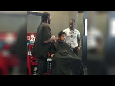 Police officer buys kids back-to-school haircuts
