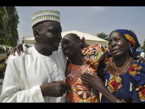 Freed Nigerian schoolgirls meet families in emotional reunions after 3 years