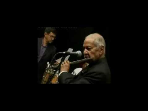 V S Shirali playing harmonica with Manohari Singh.