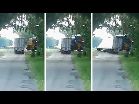 "Thumbnail: Train hits truck carrying watermelon witness yells ""Oh damn!"""
