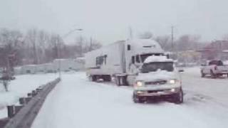 12-19-08 F150 pulls semi truck up snowy off ramp