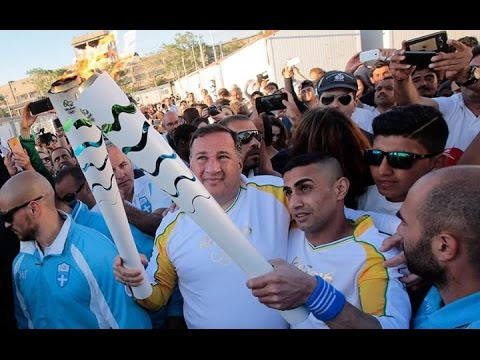 Disabled Syrian Athlete Carries Olympic Torch Through Refugee Camp