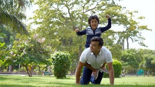 Handsome man playing with his son on a beautiful summer day - family leisure time