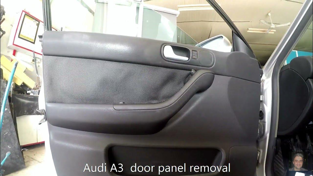 desmontar panel puerta audi a4 2005